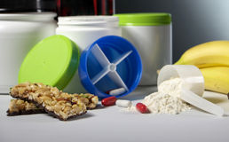 Sport Nutrition Supplement containers with pills Royalty Free Stock Photo
