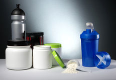Sport Nutrition Supplement containers with shaker. Workout Sport Nutrition Supplement containers Stock Photos