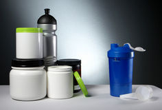 Sport Nutrition Supplement containers with shaker Royalty Free Stock Image