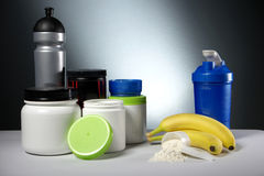 Sport Nutrition Supplement containers with shaker Royalty Free Stock Images