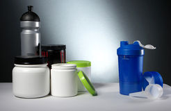 Sport Nutrition Supplement containers with shaker Royalty Free Stock Photos