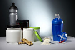 Sport Nutrition Supplement containers with shaker Royalty Free Stock Photography