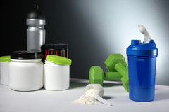 Sport Nutrition Supplement containers with shaker Stock Photography