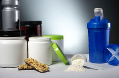 Sport Nutrition Supplement containers with shaker Royalty Free Stock Photo