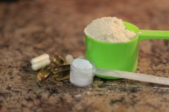 Sport nutrition, supplements: protein, pre-workout complex, bcaa, FISH OIL AND OTHERS. Sport nutrition, supplements: protein, pre-workout complex, bcaa, TAKING stock images