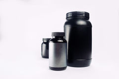 Sport Nutrition, Whey Protein and Gainer. Black Plastic Jars iso Royalty Free Stock Photos