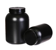 Sport Nutrition, Whey Protein and Gainer in Black Plastic Jars Stock Photography