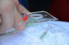 Sport orienteering. A compass with marked degrees and  a paper map. Learning orientation Royalty Free Stock Image