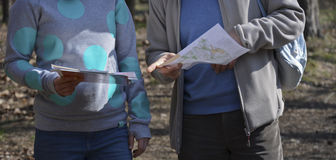 Sport orienteering. A teenage girl and a teacher with a map. Learning orientation Stock Image