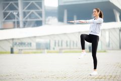 Sport outdoor. Woman Listening Music On Phone While Exercising Outdoors.  stock photography