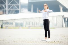 Sport outdoor. Woman Listening Music On Phone While Exercising Outdoors.  stock image