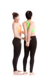 Sport partners assisting each other in warming up exercises Royalty Free Stock Images