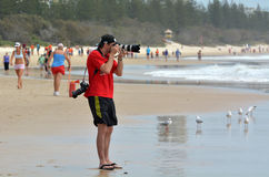 Sport photographer photographing on the beach Royalty Free Stock Photo