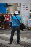 Sport Photographer Shooting Marathon Runners Ready for the Race at Starting Line.  Stock Images