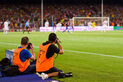 Sport photographers. BARCELONA - AUGUST 17: Unidentified photographers work at the Spanish Super Cup final match between FC Barcelona and Real Madrid, 3 - 2, on royalty free stock image