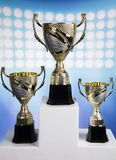 Sport podium, Cups of winners award. Cups of winners award on white podium, sport background stock image