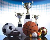 Sport podium, Cups of winners award. Trophy Winning, sport ball background Stock Photos