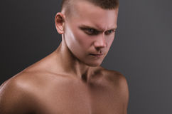 Sport portrait. Concept. Healthy muscular young man.  Sport portrait.  Emotion Royalty Free Stock Image