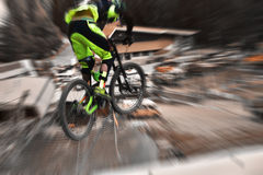 Sport race Mountain biker extreme and fun downhill track. Jumps and dirt splashes. Royalty Free Stock Photo