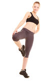 sport ragazza bionda sportiva di forma fisica che allunga gamba i Fotografia Stock Libera da Diritti