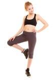 sport ragazza bionda sportiva di forma fisica che allunga gamba isolata Immagini Stock Libere da Diritti