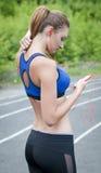 Sport, ragazza e musica Fotografie Stock