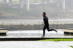 Sport in the rain Royalty Free Stock Photography
