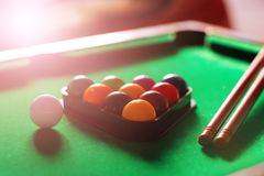 Sport, recreation, game, competition - Playing billiard. Billiards balls an cue on billiards table. stock images