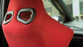 Sport red bucket seat in Toyota Yaris eco car Royalty Free Stock Photo