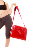 Sport. Red gym bag of fitness sporty girl in sportswear Stock Images