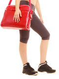 Sport. Red gym bag of fitness sporty girl in sportswear Royalty Free Stock Image