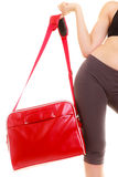 Sport. Red gym bag of fitness sporty girl in sportswear Stock Image