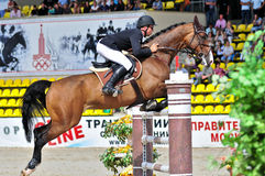 Sport. Rider with horse jumps over barrier Royalty Free Stock Photo