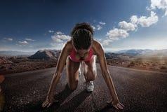 Sport. Runner. Young sportswoman starting stock photo