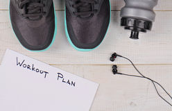 Sport, Running concept. Running shoes and workout plan on white background. Stock Image