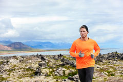 Sport running man in cross country trail run. Male runner exercising and training outdoors in beautiful mountain nature landscape on Snaefellsnes, Iceland Royalty Free Stock Photography
