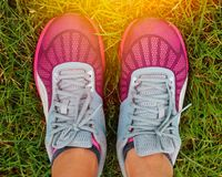 Sport running shoes. With grass background Royalty Free Stock Photo