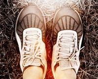 Sport running shoes. With grass background Royalty Free Stock Photos