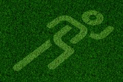 Sport running sing on green grass for background. Run icon on the ground, run way, running space stock photography