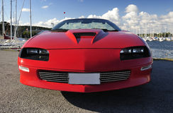Sport's car front view. Red fast sport car in summer Swedish harbor Royalty Free Stock Photography
