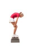Sport serie: Kroków aerobiki Rozciąganie plecy Obrazy Stock
