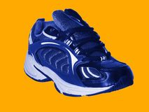 Sport shoe. Isolated on yellow; athletic lifestyle Royalty Free Stock Photography