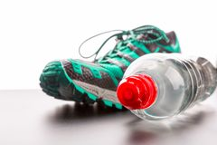 Sport shoe and a bottle of water closeup Stock Photography