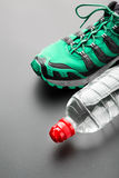 Sport shoe and a bottle of water Stock Photography