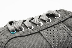 Sport Shoe Closeup. Closeup image of a gray sport shoe on white background Stock Photo