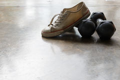 Sport shoe and metal dumbbell, fitness sport equipment Stock Photos