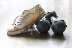 Sport shoe and metal dumbbell, fitness sport equipment Royalty Free Stock Photography