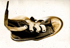 Sport shoe-old grunge sneaker. Grungy look of a old and used training sneaker royalty free stock photo