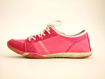 Sport Shoe. Pink used Womans sport Shoe in white Background Royalty Free Stock Photos