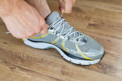 Sport shoe tying, exercise at gym Stock Images